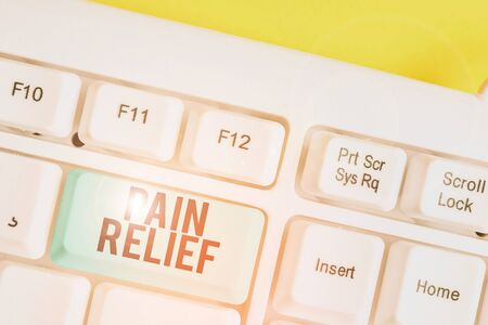 Conceptual hand writing showing Pain Relief. Concept meaning Drugs or other methods of reducing or getting rid of pain White pc keyboard with note paper above the white background