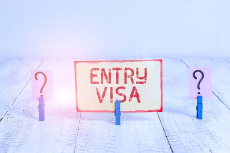 Text sign showing Entry Visa. Business photo text permission to enter a country of which you are not a national Scribbled and crumbling sheet with paper clips placed on the wooden table Stok Fotoğraf - 133730433