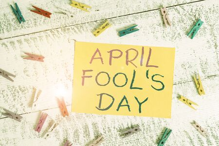 Conceptual hand writing showing April Fool S Day. Concept meaning Practical jokes humor pranks Celebration funny foolish Colored clothespin rectangle shaped paper blue background