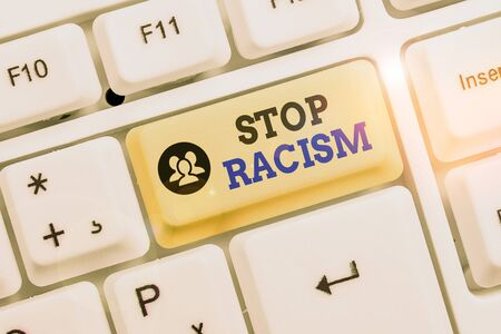 Conceptual hand writing showing Stop Racism. Concept meaning end the antagonism directed against someone of a different race Фото со стока