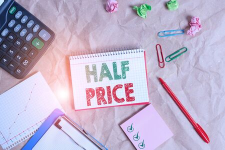 Word writing text Half Price. Business photo showcasing half the usual price at which something is offered for sale Papercraft craft paper desk square spiral notebook office study supplies Stock fotó