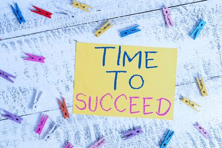 Conceptual hand writing showing Time To Succeed. Concept meaning Thriumph opportunity Success Achievement Achieve your goals Colored clothespin rectangle shaped paper blue background