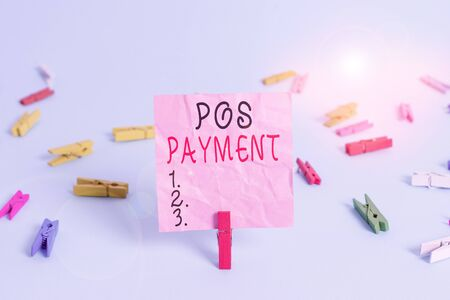Handwriting text Pos Payment. Conceptual photo customer tenders payment in exchange for goods and services Colored clothespin rectangle square shaped paper light blue background