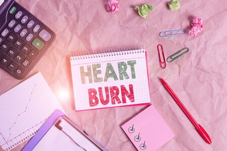 Word writing text Heart Burn. Business photo showcasing a burning sensation or pain in the throat from acid reflux Papercraft craft paper desk square spiral notebook office study supplies
