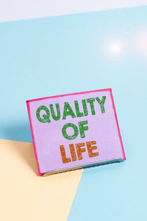 Word writing text Quality Of Life. Business photo showcasing being in good health decent job Enjoying every moment Paper placed tilted above buffer wire on soft pastel multi colours backdrop