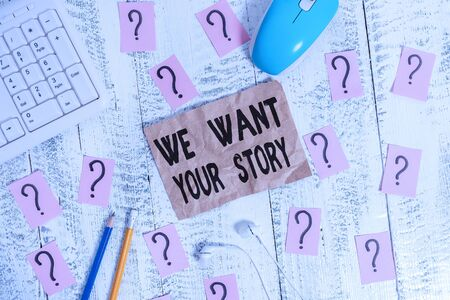Text sign showing We Want Your Story. Business photo showcasing Tell Us something a Glimpse About Your Life History Writing tools, computer stuff and scribbled paper on top of wooden table