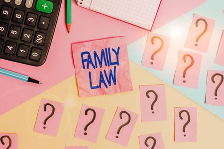 Handwriting text Family Law. Conceptual photo the branch of law that deals with matters relating to the family Mathematics stuff and writing equipment above pastel colours background