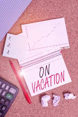Conceptual hand writing showing On Vacation. Concept meaning period spent away from home or business in travel or recreation Desk notebook paper office paperboard study supplies chart