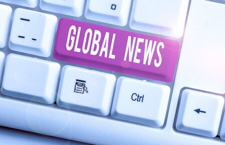 Writing note showing Global News. Business concept for world noteworthy information about recent or important events White pc keyboard with note paper above the white background