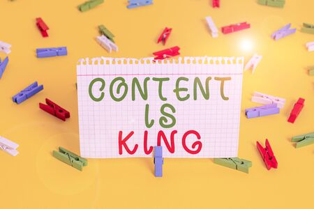 Handwriting text Content Is King. Conceptual photo words what sells products and provide good marketing Colored clothespin papers empty reminder yellow floor background office