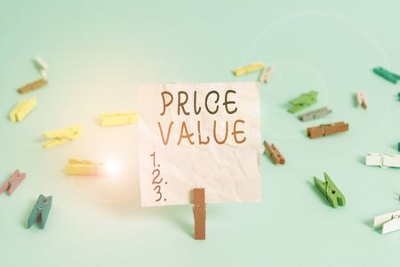 Handwriting text Price Value. Conceptual photo the price of a product based on what customers think or valued Colored clothespin rectangle square shaped paper light blue background