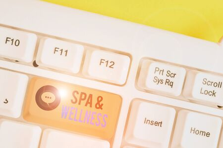 Conceptual hand writing showing Spa And Wellness. Concept meaning Place where showing go to improve their health Relaxation White pc keyboard with note paper above the white background