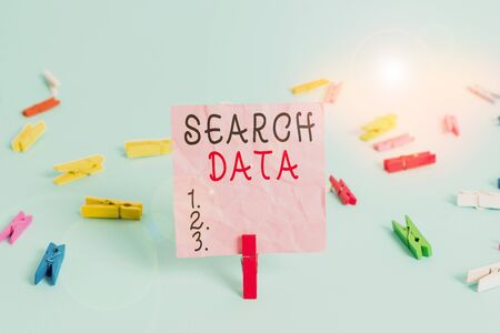 Handwriting text Search Data. Conceptual photo efficient retrieval of specific items from a set of items Colored clothespin rectangle square shaped paper light blue background