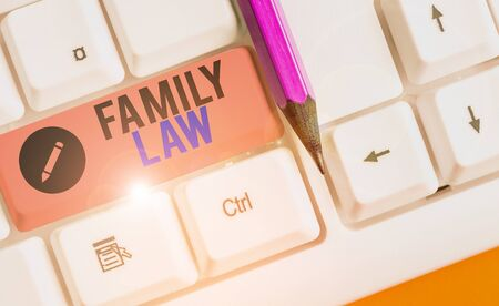 Writing note showing Family Law. Business concept for the branch of law that deals with matters relating to the family