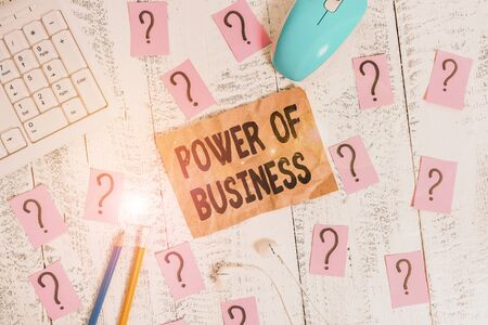 Text sign showing Power Of Business. Business photo showcasing The ability to influence peers for attaining the goals Writing tools, computer stuff and scribbled paper on top of wooden table