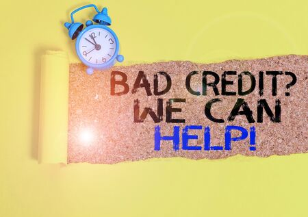 Handwriting text writing Bad Credit Question We Can Help. Conceptual photo offering help after going for loan then rejected Alarm clock and torn cardboard placed above a wooden classic table backdrop