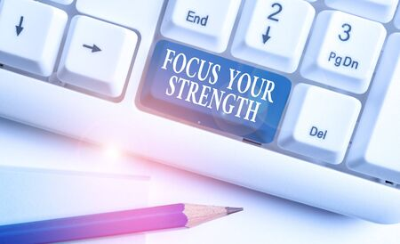 Conceptual hand writing showing Focus Your Strength. Concept meaning Improve skills work on weakness points think more White pc keyboard with note paper above the white background