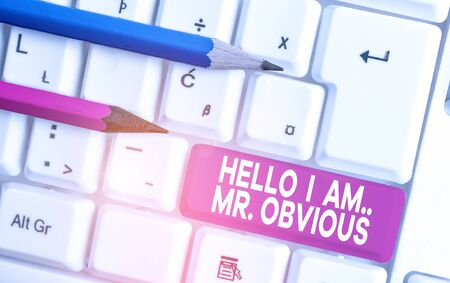 Text sign showing Hello I Am Mrobvious. Business photo text introducing yourself as pouplar or famous demonstrating White pc keyboard with empty note paper above white background key copy space Фото со стока