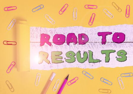 Word writing text Road To Results. Business photo showcasing Business direction Path Result Achievements Goals Progress Stationary and torn cardboard placed above a wooden classic table backdrop