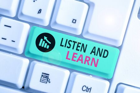 Writing note showing Listen And Learn. Business concept for Pay attention to get knowledge Learning Education Lecture