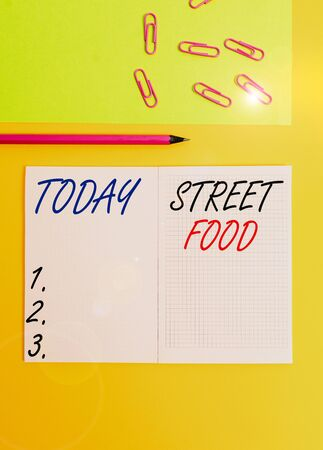Handwriting text writing Street Food. Conceptual photo cooked food sold by vendors in a street or other public location Blank squared notebook pencil marker paper sheet plain colored background