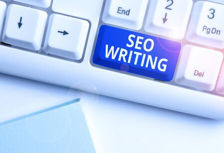 Conceptual hand writing showing Seo Writing. Concept meaning grabbing the attention of the search engines using specific word White pc keyboard with note paper above the white background