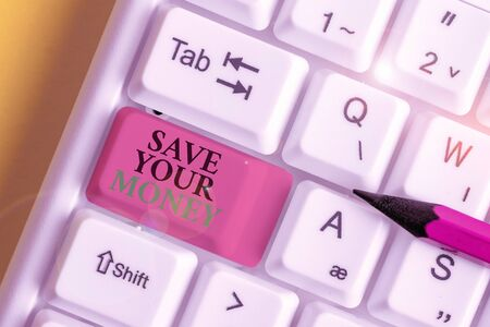 Conceptual hand writing showing Save Your Money. Concept meaning keep your savings in bank or stock to protect it Dont waste White pc keyboard with note paper above the white background