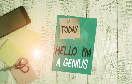 Writing note showing Hello I M A Genius. Business concept for Introduce yourself as over average demonstrating to others Envelope paper sheet smartphone notepads scissors wooden background Stock fotó