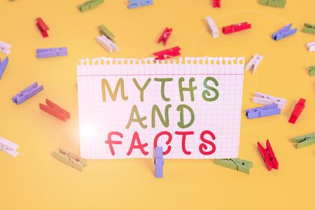 Handwriting text Myths And Facts. Conceptual photo Oppositive concept about modern and ancient period Colored clothespin papers empty reminder yellow floor background office