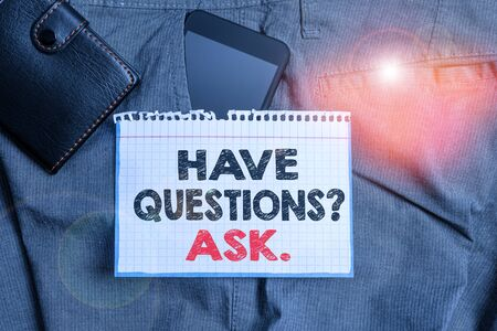 Writing note showing Have Questionsquestion Ask. Business concept for something that you say or write to ask a demonstrating Smartphone device inside trousers front pocket with wallet Stok Fotoğraf