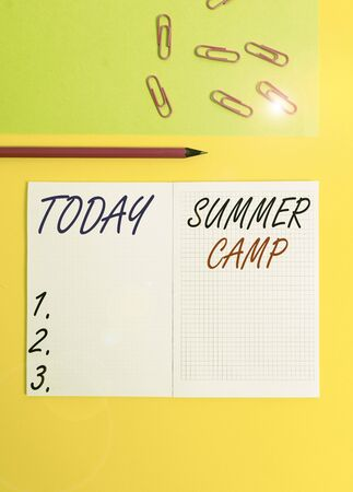 Handwriting text writing Summer Camp. Conceptual photo supervised program for children conducted during the summer Blank squared notebook pencil marker paper sheet plain colored background