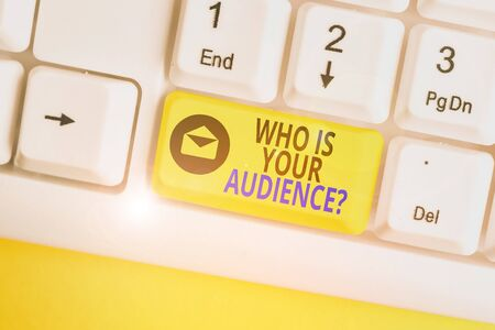 Word writing text Who Is Your Audience Question. Business photo showcasing who is watching or listening to it White pc keyboard with empty note paper above white background key copy space Фото со стока