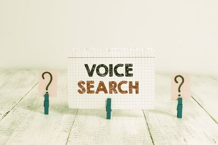 Text sign showing Voice Search. Business photo showcasing allows the user to use a voice comanalysisd to search the Internet Scribbled and crumbling sheet with paper clips placed on the wooden table