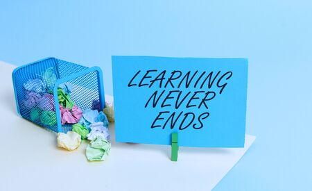 Writing note showing Learning Never Ends. Business concept for Life Long Educational and Wellness Opportunities Trash bin crumpled paper clothespin reminder office supplies