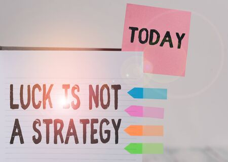 Word writing text Luck Is Not A Strategy. Business photo showcasing it is not being Lucky when planned intentionally Hard cover note book sticky note arrow banners inserted clear background Reklamní fotografie
