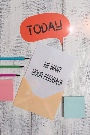Writing note showing We Want Your Feedback. Business concept for to Improve Perforanalysisce or Product Timely Reaction Envelop speech bubble paper sheet ballpoints notepads wooden background Stock fotó
