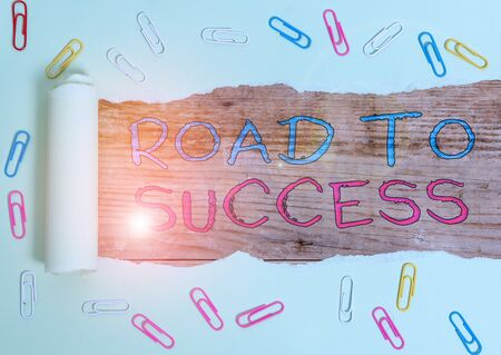 Writing note showing Road To Success. Business concept for studying really hard Improve yourself to reach dreams wishes Paper clip and torn cardboard on wood classic table backdrop