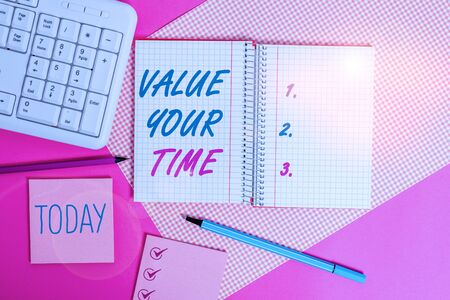 Handwriting text writing Value Your Time. Conceptual photo asking someone to make schedule and get beat of his life Writing equipments and computer stuffs placed above colored plain table