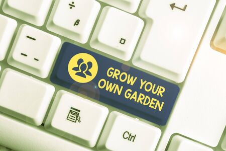 Handwriting text writing Grow Your Own Garden. Conceptual photo Organic Gardening collect demonstratingal vegetables fruits White pc keyboard with empty note paper above white background key copy space
