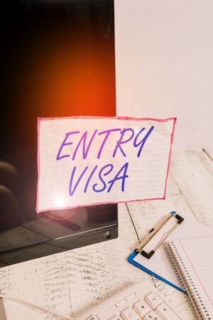 Text sign showing Entry Visa. Business photo text permission to enter a country of which you are not a national Note paper taped to black computer screen near keyboard and stationary Stok Fotoğraf - 133732191