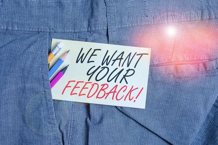 Writing note showing We Want Your Feedback. Business concept for criticism given someone say can be done for improvement Writing equipment and yellow note paper inside pocket of man trousers