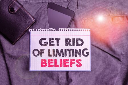 Writing note showing Get Rid Of Limiting Beliefs. Business concept for remove negative beliefs and think positively Smartphone device inside trousers front pocket with wallet