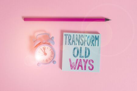 Word writing text Transform Old Ways. Business photo showcasing replace it with new methods Alternatives new solution Metal vintage alarm clock wakeup blank notepad marker colored background