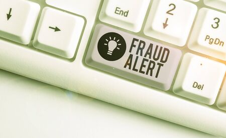 Text sign showing Fraud Alert. Business photo showcasing security alert placed on credit card account for stolen identity White pc keyboard with empty note paper above white background key copy space Reklamní fotografie