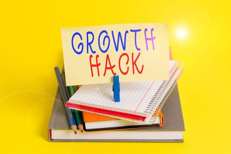 Conceptual hand writing showing Growth Hack. Concept meaning generally to acquire as analysisy users or customers as possible Book pencil rectangle shaped reminder notebook clothespins