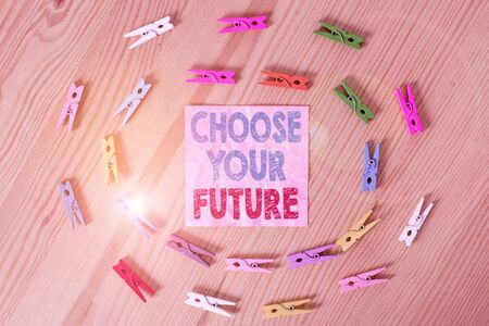 Conceptual hand writing showing Choose Your Future. Concept meaning Choices make today will define the outcome of tomorrow Colored crumpled papers wooden floor background clothespin