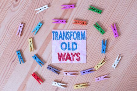 Conceptual hand writing showing Transform Old Ways. Concept meaning replace it with new methods Alternatives new solution Colored crumpled papers wooden floor background clothespin