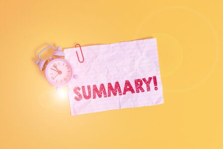 Text sign showing Summary. Business photo showcasing a brief statement or account of the main points of something Metal alarm clock clip blank crushed note sheet colored background