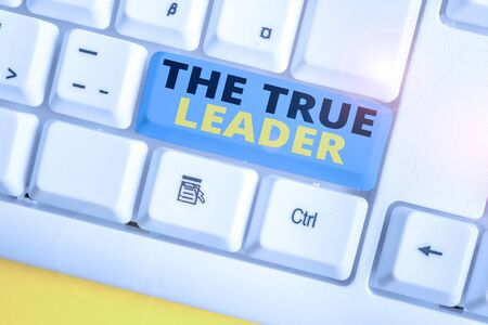 Text sign showing The True Leader. Business photo text one that move and encourage group of showing Responsibility White pc keyboard with empty note paper above white background key copy space