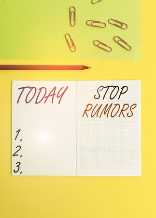 Handwriting text writing Stop Rumors. Conceptual photo put an end circulating the story of uncertain or doubtful truth Blank squared notebook pencil marker paper sheet plain colored background Stock fotó